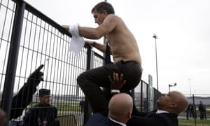 Air France human resources chief Xavier Broseta scaling a fence after being chased out of a meeting about restructuring proposals