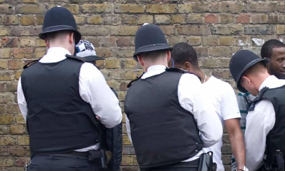 Police stop and search black youths at the entrance to the Notting Hill Carnival in London