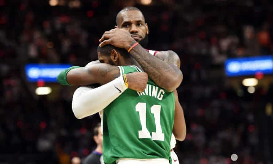 LeBron James and Kyrie Irving hug after the Cavs beat the Celtics