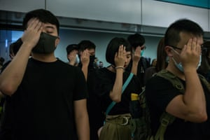 Protesters cover their right eye in solidarity with a medic who was shot in the face by police. Hong Kong, 21 August 2019