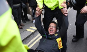 George Monbiot being arrested by police during an Extinction Rebellion protest in London on 16 October 2019.