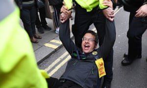 George Monbiot being arrested by police during an Extinction Rebellion protest in London, 16 October 2019.