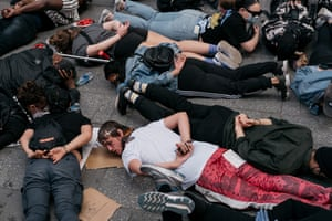 Demonstrators stage a momentary die-in and chant during a rally in New York's Times Square today denouncing racism in law enforcement and the May 25 killing of George Floyd while in the custody of Minneapolis police.