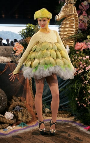 The Budgie Girl dress, made with tulle, feathers, and crystals, was one of the many highlight of the Doilies and Pearls, Oysters and Shells spring/summer 2009/10 show. The show was to be a tribute to the pair's grandmothers and to growing up near the sea, hence the title. The 'Cate Blanket' crocheted dress was also part of this collection.