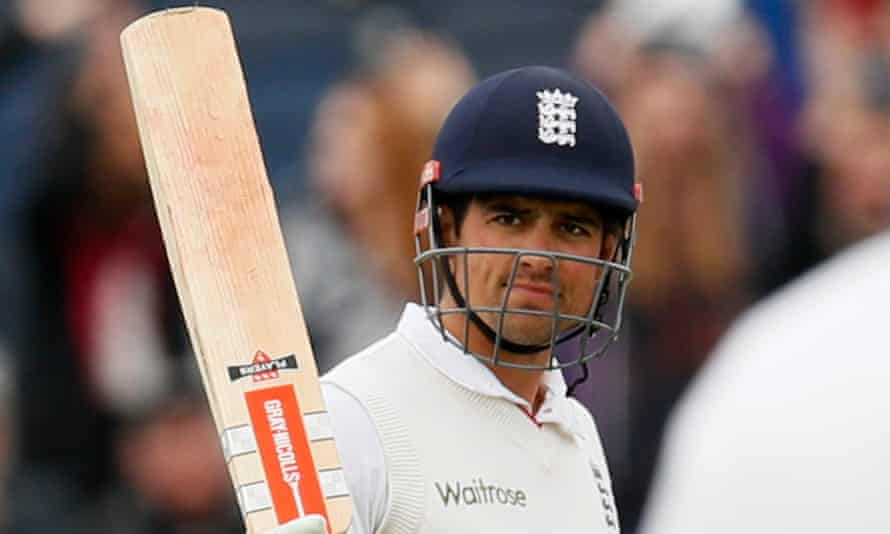 England's Alastair Cook celebrates reaching 10,000 Test runs in the match against Sri Lanka