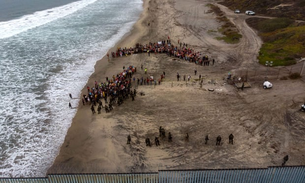Activists demonstrating against US migration policies gather near the US-Mexico border fence at Imperial beach in San Diego.