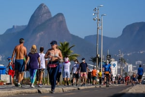 People enjoy the weather at Ipanema beach on 5 July 2020 in Rio de Janeiro, Brazil, on the first Sunday since the mayor has lifted most of the coronavirus restrictions.