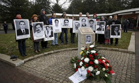 Pictures of people killed by the NSU are held up, in 2013, besides a memorial to cafe owner Halit Yozgat.