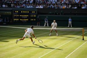 Novak Djokovic plays a forehand.