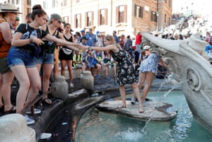 Rome, Italy People fill bottles from the Barcaccia fountain in the Piazza di Spagna