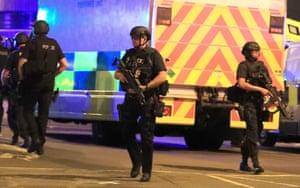 Armed police guard the scene.