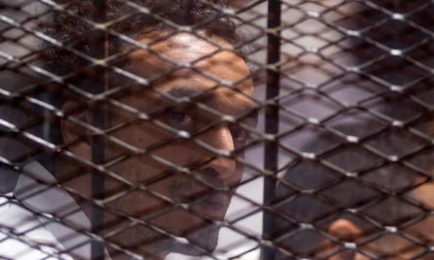 Egyptian photojournalist Mahmoud Abu Zeid, better known as Shawkan, at his trial in Cairo