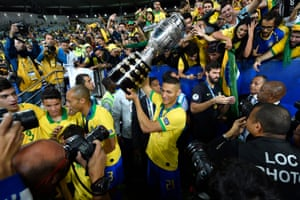 Richarlison lifts the trophy after Brazil beat Peru to win the 2019 Copa América.