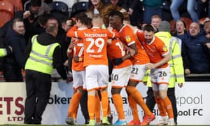 Blackpool's players celebrate after Dan Butler's own goal.