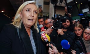 Marine Le Pen speaks to journalists as she leaves the court in Lyon, France.
