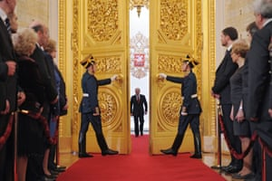 Vladimir Putin enters the tsars' former throne room for his third inauguration as thousands of opposition activists clashed with police outside the Kremlin.