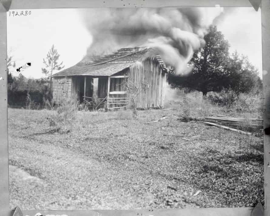 A black resident's home in shown in flames during the race riots in 1923.