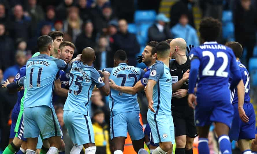 Players square up to each other after Sergio Agüero's foul on David Luiz, which led to a red card for the Manchester City striker followed by one for Fernandinho.