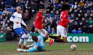 Scott Davies concedes a penalty for a foul on Manchester United's Tahith Chong during Tranmere's heavy defeat