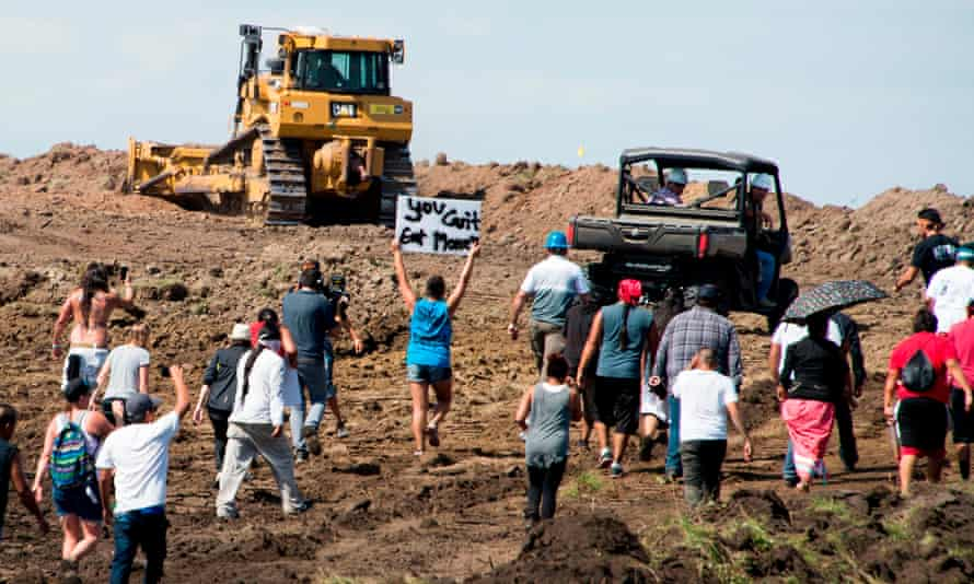 Native American protesters and supporters are confronted by security during a demonstration against the Dakota Access pipeline near Cannon Ball, North Dakota, on 3 September 2016.