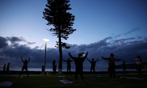 Women train during an outdoor fitness session at Manly beach.