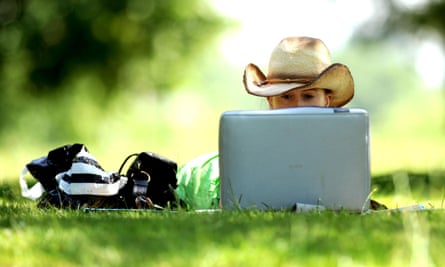 A woman uses a laptop on a hot day
