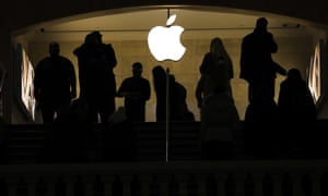 People shop in an Apple retail store in Grand Central Terminal Tuesday in New York City.