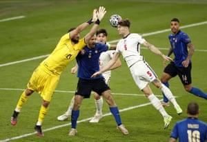 Goalkeeper Gianluigi Donnarumma of Italy in action against John Stones of England,