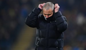 Jose Mourinho adjusts his snood on a cold night in Hull.