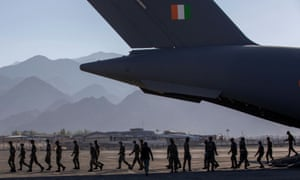 Indian soldiers disembark from a military transport plane at a forward airbase in Leh, Ladakh.