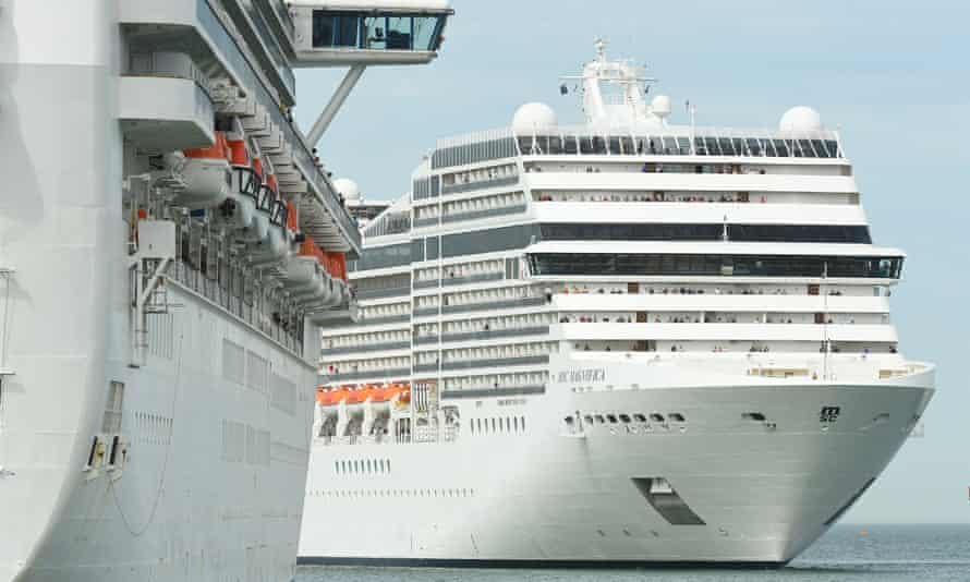 The MSC Magnifica cruise ship (right) alongside the Golden Princess cruise ship in Melbourne, 19 March 2020