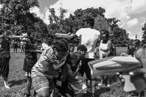 Children from Reservoir Hill participate in a water fight at Druid Hill Park as part of the Ceasefire festivities