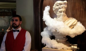 A bust wreathed in clouds of gas from a tear gas canister.