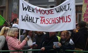 Demonstrators hold up a banner reading 'Who votes for Höcke votes for fascism' referring to AfD candidate Björn Höcke.