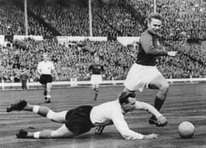 England goalkeeper Eddie Hopkinson dives at the feet of Agne Simonsson during Sweden's 3-2 win at Wembley in October 1959.