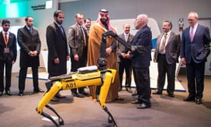 Saudi crown prince Mohammed bin Salman looks at a quadrupled robot during his visit to MIT on 24 March.