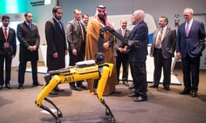 Crown Prince Mohammed bin Salman, centre, inspects at a quadruped robot during his visit to the Massachusetts Institute of Technology (MIT) in Cambridge, Massachusetts.