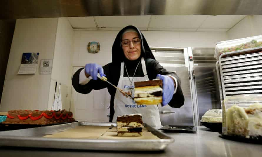 Sister Mary Valerie places cake on a tray to serve at the Fraternite Notre Dame Mary of Nazareth soup kitchen in San Francisco.