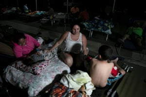 People in Yauco at a makeshift camp outside their apartment building