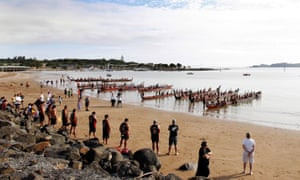 Some of the Nineteen Maori Waka line the beach in the early morning ahead of the Waitangi celebrations, Waitangi, Bay of Islands, New Zealand.