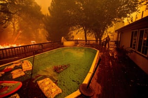A firefighter gathers water from a pool while battling the Ranch Fire near Clearlake Oaks.