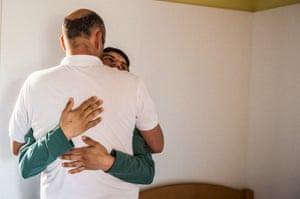 Kostas hugging a support worker