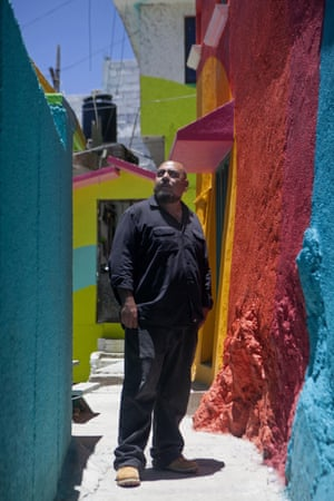 Project director Enrique Gomez, who goes by MYBE, poses for a portrait in the Palmitas neighborhood, in Pachuca, Mexico, Thursday, July 30, 2015. Gomez said,