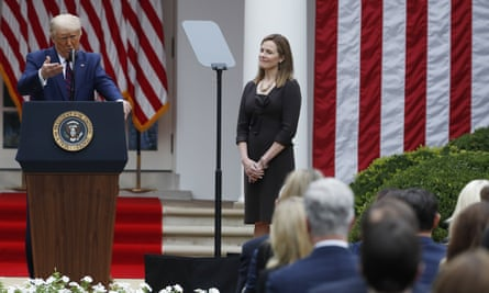 US President Donald J. Trump introduces Judge Amy Coney Barrett as his nominee to be an Associate Justice of the Supreme Court<br>epa08700042 US President Donald J. Trump introduces Judge Amy Coney Barrett (R) as his nominee to be an Associate Justice of the Supreme Court during a ceremony in the Rose Garden of the White House in Washington, DC, USA, 26 September 2020. Judge Barrett, if confirmed, will replace the late Justice Ruth Bader Ginsburg. EPA/SHAWN THEW
