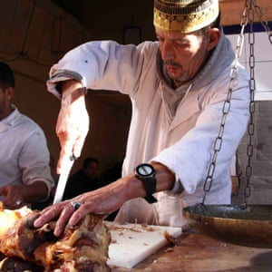 Chef at work carving meat at Chez Lamine, Marrakech, Morocco.