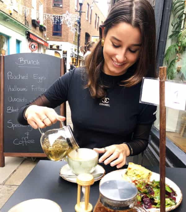 a woman pours tea in a cafe