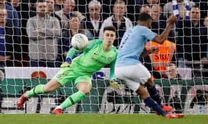 Manchester City's Raheem Sterling scores the winning penalty past Kepa
