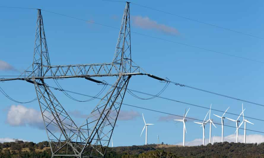 High-tension power lines stand near the wind turbines operating on Capital windfarm in Bungendore