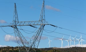 High tension power lines stand near the wind turbines operating on Capital Wind Farm in Bungendore, Australia.