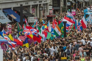 Thousands of people pack Oxford Circus and Regent Street to watch the parade